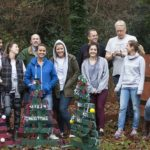BaxterStorey volunteers don wellies and overalls to support community projects
