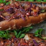 Vegetarian Foodservice Recipe: 'Boerie Pretzel Roll' topped with Asian Chakalaka