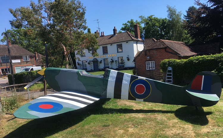 Pub reopens with a full size Spitfire to mark the occasion